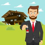 Agent immobilier masculin d'agent immobilier montrant la clé de maison devant la maison Images stock