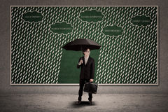 Agent insurance hold umbrella to protect business loss. Agent insurance holding umbrella while standing in front of hand drawn illustration (rain and clouds Royalty Free Stock Photos