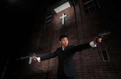 Agent/ Killer pointing guns towards target Stock Image
