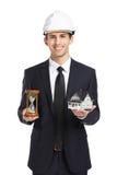 Agent nieruchomości ręk modela hourglass i dom Zdjęcie Royalty Free