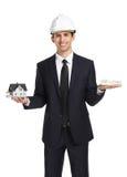Agent nieruchomości ręk modela pieniądze i dom Fotografia Stock