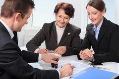 Agent with senior woman and her daughter Royalty Free Stock Photography