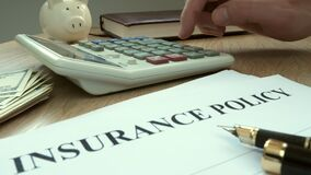 Agent calculating cost of insurance policy.
