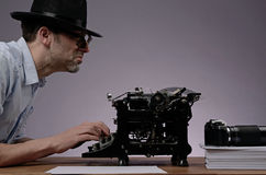 Agent with an old type writer and a vintage camera Stock Photography
