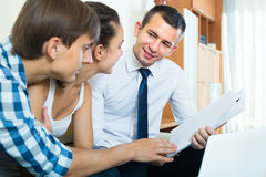 Agent with papers and young couple Royalty Free Stock Image