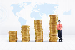 Agent and rising gold coins chart Stock Images