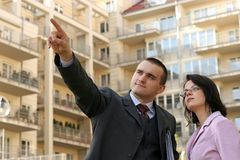 Agent showing flat location stock photography