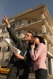 Agent showing flat location. Real estate agent showing flat location to potential client Stock Photography