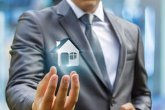 Agent shows the house model . Stock Photo