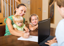 Agent talking with mother and kids Stock Photo