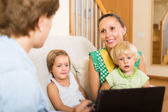 Agent talking with mother and kids Royalty Free Stock Photography