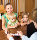 Agent talking with mother and kids Stock Photos