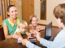 Agent talking with mother and kids Stock Photography