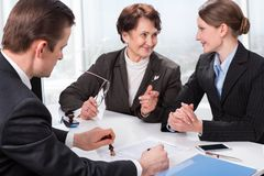 Agent With Senior Woman And Her Daughter Stock Image
