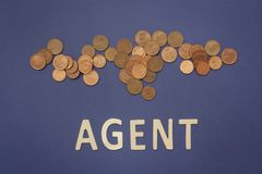 Agent written with wooden letters on a blue background. To mean a business concept Stock Images