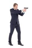 Agenta specjalnego mężczyzna w garniturze pozuje z pistoletem odizolowywającym na w Fotografia Royalty Free