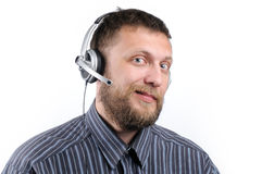 Agente Charming do serviço de atenção a o cliente em auriculares Fotografia de Stock Royalty Free