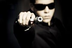 Agente con el arma Imágenes de archivo libres de regalías