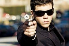 Agente con la pistola Fotografie Stock Libere da Diritti