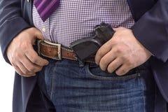 Agente de seguridad del primer en traje de negocios con el arma de la mano atado en la correa En blanco fotografía de archivo libre de regalías