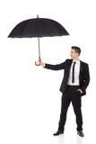 Agente de seguros que guarda o guarda-chuva Fotografia de Stock Royalty Free