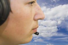 Agente de viajes con los auriculares Foto de archivo
