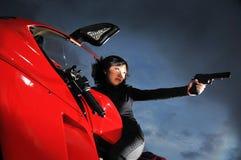 Agente del asesino de la mujer en una moto Fotografía de archivo