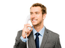 Agente del servicio de atención al cliente que lleva a cabo el fondo del blanco del teléfono Fotos de archivo libres de regalías