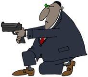 Agente federale che prende scopo con la sua pistola Immagine Stock