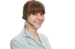 Agente hermoso de la atención al cliente con el receptor de cabeza Foto de archivo