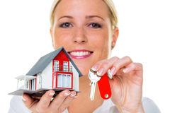 Agente inmobiliario con la casa y la llave Fotografía de archivo libre de regalías