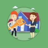 Agente inmobiliario que da llave al dueño de nueva casa Imágenes de archivo libres de regalías