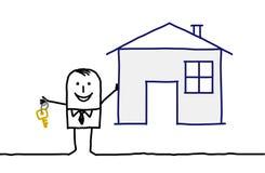 Agente inmobiliario y casa Fotografía de archivo libre de regalías
