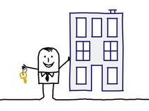 Agente inmobiliario y edificio Fotos de archivo libres de regalías