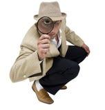 Agente investigativo di seduta Fotografie Stock Libere da Diritti