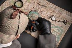 Agente investigativo e mappa di Londra Fotografie Stock Libere da Diritti