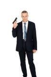 Agente serio de la mafia con la arma de mano Imagen de archivo libre de regalías