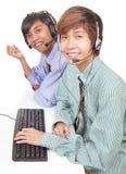 Agentes asiáticos del centro de ayuda imagenes de archivo