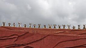 Agentes chinos de la minoría en el teatro al aire libre por Imagenes de archivo