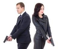 Agentes especiales del hombre y de la mujer con los armas aislados en blanco fotografía de archivo libre de regalías
