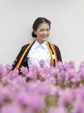 Ager teenager tailandese in uniforme laureata Fotografia Stock Libera da Diritti