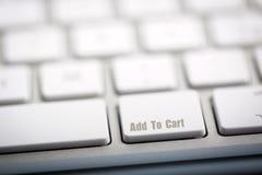 Aggiunga al carretto sulla tastiera Immagine Stock