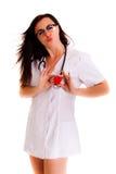 Aggiusti la donna del cuore isolata sul personale bianco del personale medico del fondo immagini stock