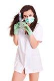 Aggiusti la donna isolata sul personale bianco del personale medico del fondo fotografie stock