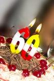 Agglutini con la ciliegia ed il cioccolato per 60 anni Immagini Stock