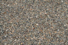 Aggregate Sidewalk Texture. Surface texture of a concrete sidewalk with exposed aggregate stock photography