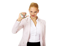 Aggresive business woman crushing small house Stock Image