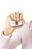 Aggresive business woman crushing small house Royalty Free Stock Photos