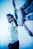 Aggresive man. Man with outstretched hand reaching for camera in aggressive pose Stock Photo