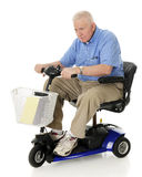 Aggresive Senior Scooter Driver Stock Image